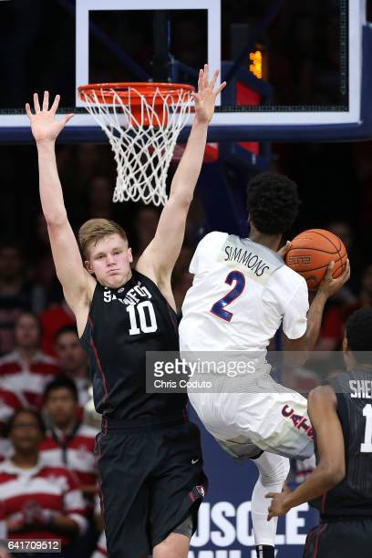 Michael Humphrey of the Stanford Cardinal defends Kobi Simmons of the Arizona Wildcats during the first half of the college basketball game at McKale...