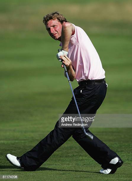 Michael Hunt of England encourages his ball to turn on the 15th hole during his match versus Daniel Perrett of England in the final of The British...