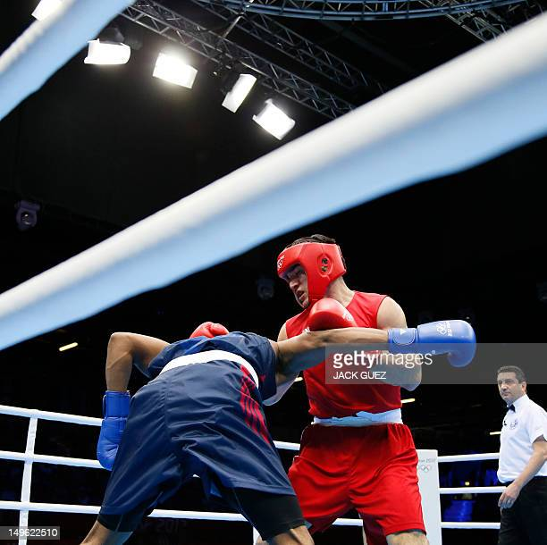 Michael Hunter Ii of the USA defends against Artur Beterbiev of Russia during their round of 16 Heavyweight boxing match of the London 2012 Olympics...