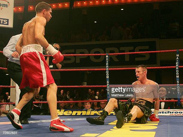 Michael Hunter of Great Britain is knocked down during the fourth round against Steve Molitor of Canada during the IBF Super Bantamweight Crown at...