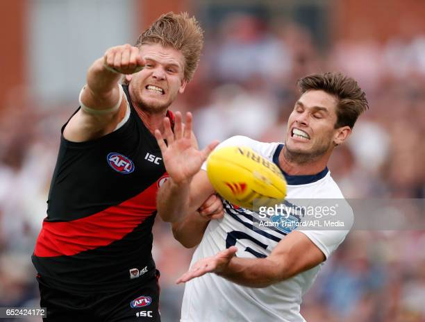 Michael Hurley of the Bombers and Tom Hawkins of the cats compete for the ball during the AFL 2017 JLT Community Series match between the Geelong...