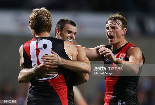 Michael Hurley of the Bombers celebrates his goal with Brent Stanton and Brendon Goddard during the round three AFL match between the Fremantle...