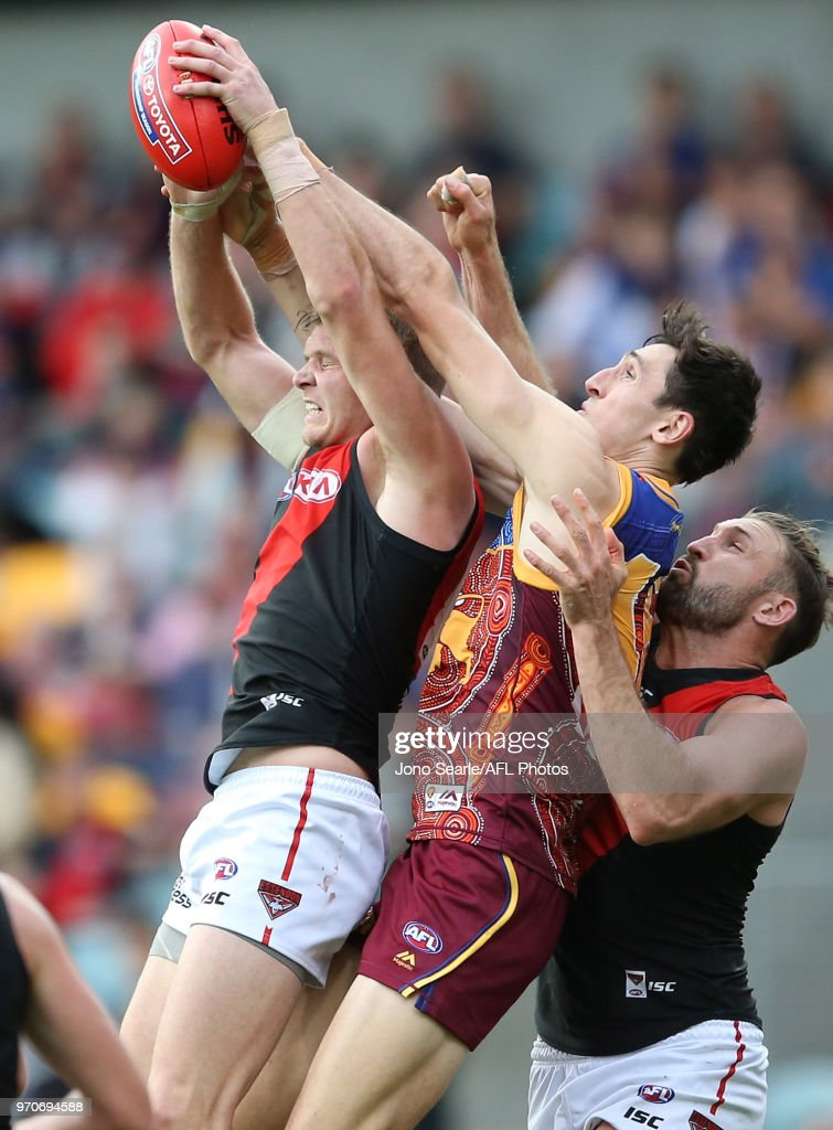 Michael Hurley of the Bombers contests the ball with Oscar McInerney of the Lions during the 2018 AFL round 12 match between the Brisbane Lions and the Essendon Bombers at The Gabba on June 10, 2018 in Brisbane, Australia.