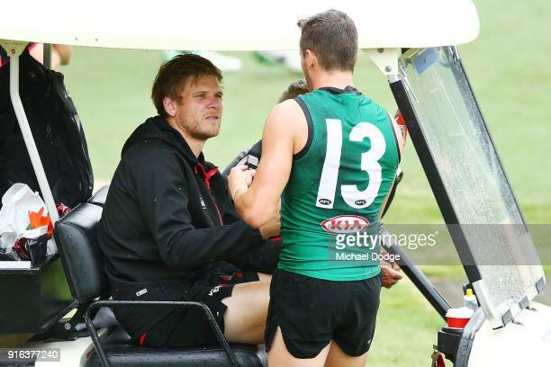 Michael Hurley of the Bombers is comforted by Orazio Fantasia after coming off with an injured wrist during the Essendon Bombers AFL IntraClub Match...