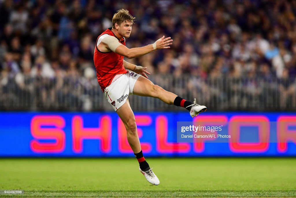 Michael Hurley of the Bombers kicks the ball during the 2018 AFL round 02 match between the Fremantle Dockers and the Essendon Bombers at Optus Stadium on March 31, 2018 in Perth, Australia.