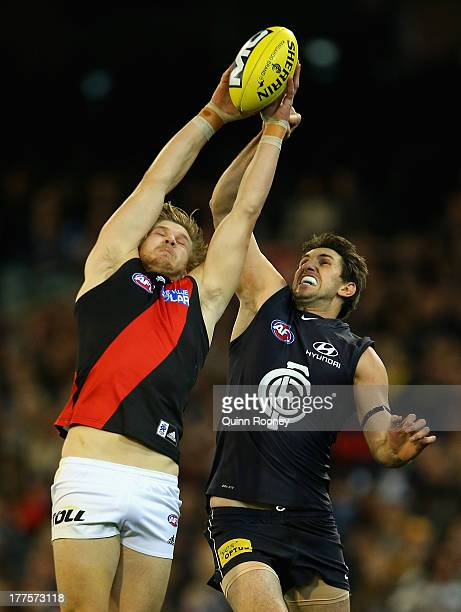 Michael Hurley of the Bombers marks infront of Jarrad Waite of the Blues during the round 22 AFL match between the Carlton Blues and the Essendon...
