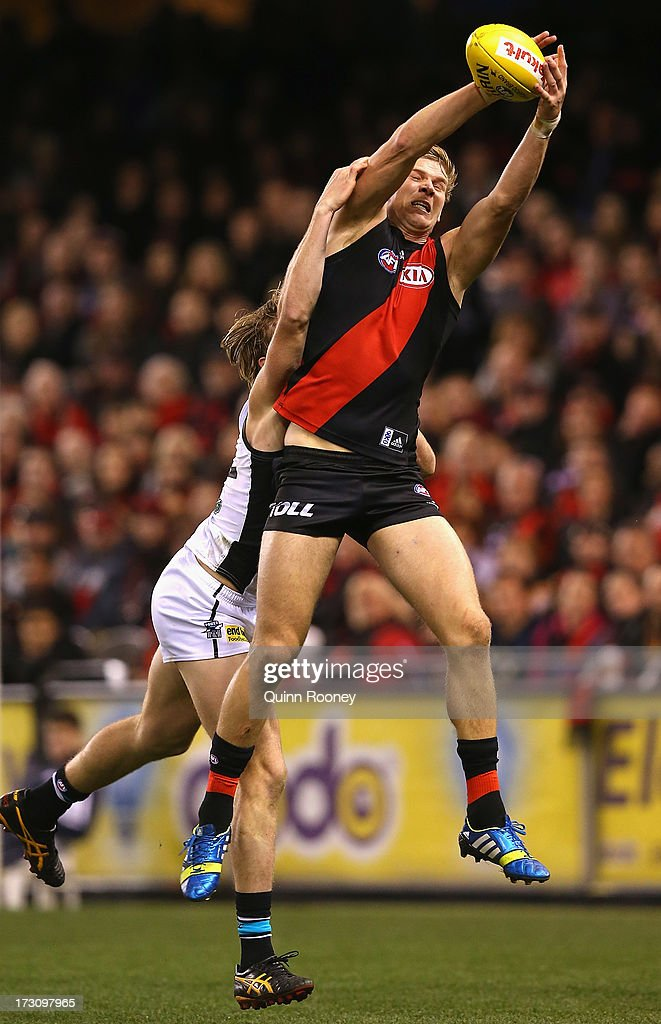 Michael Hurley of the Bombers marks infront of Thomas Jonas of the Power during the round 15 AFL match between the Essendon Bombers and Port Adelaide Power at Etihad Stadium on July 7, 2013 in Melbourne, Australia.