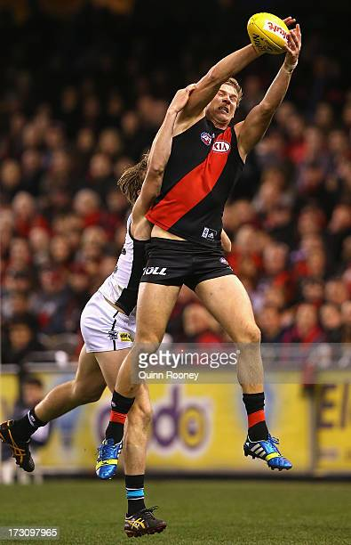 Michael Hurley of the Bombers marks infront of Thomas Jonas of the Power during the round 15 AFL match between the Essendon Bombers and Port Adelaide...