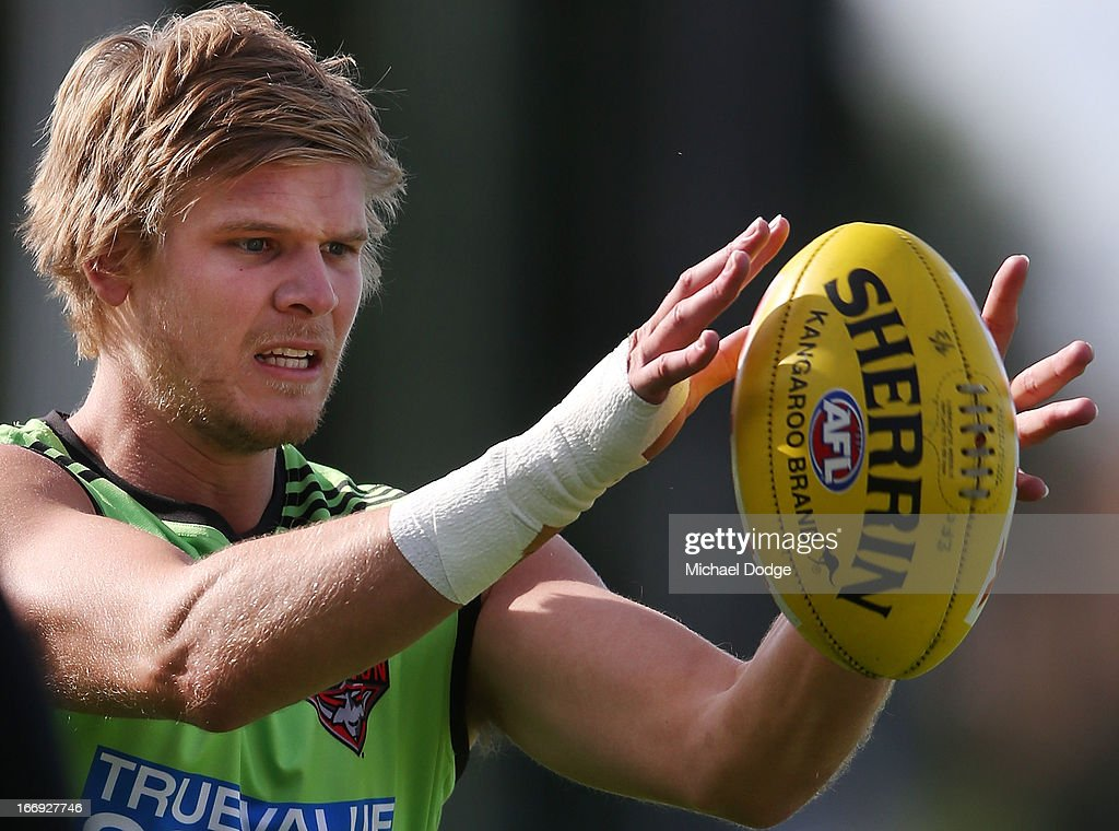 Michael Hurley of the Bombers marks the ball with his bandaged up hand during an Essendon Bombers AFL training session at Windy Hill on April 19, 2013 in Melbourne, Australia.
