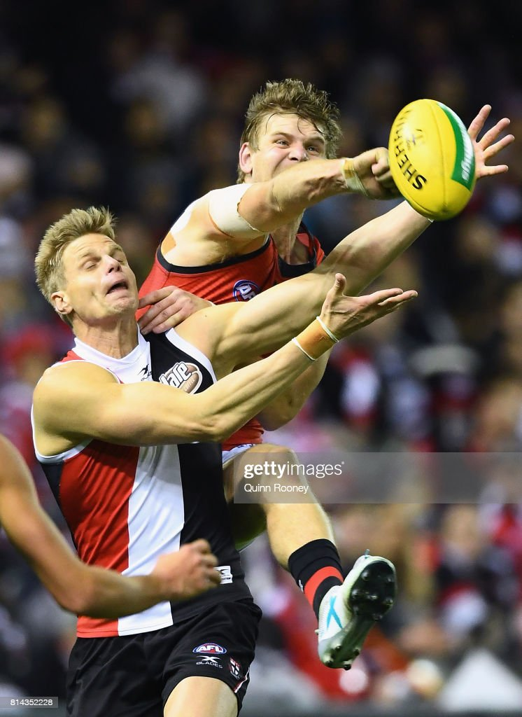 Michael Hurley of the Bombers spoils a mark by Nick Riewoldt of the Saints during the round 17 AFL match between the St Kilda Saints and the Essendon Bombers at Etihad Stadium on July 14, 2017 in Melbourne, Australia.