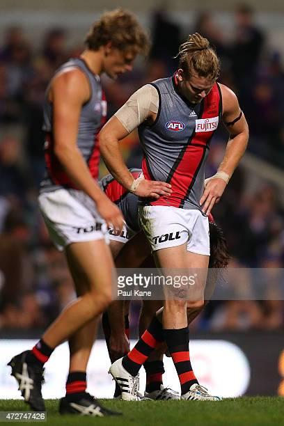 Michael Hurley of the Bombers walks to the quarter time huddle during the round six AFL match between the Fremantle Dockers and the Essendon Bombers...