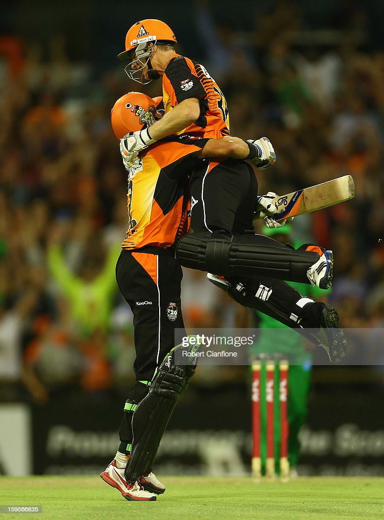 Michael Hussey and Adam Voges of the Perth Scorchers celebrate after the Scorchers defeated the Stars during the Big Bash League semi-final match between the Perth Scorchers and the Melbourne Stars at the WACA on January 16, 2013 in Perth, Australia.