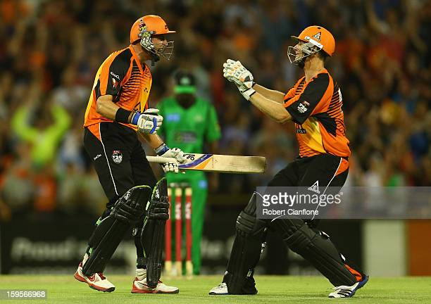 Michael Hussey and Adam Voges of the Perth Scorchers celebrate after the Scorchers defeated the Stars during the Big Bash League semifinal match...