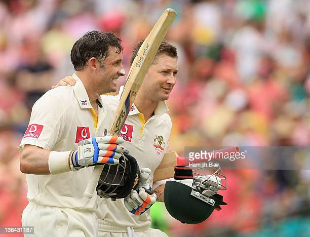 Michael Hussey and Michael Clarke of Australia leave the field together at lunch during day three of the Second Test Match between Australia and...