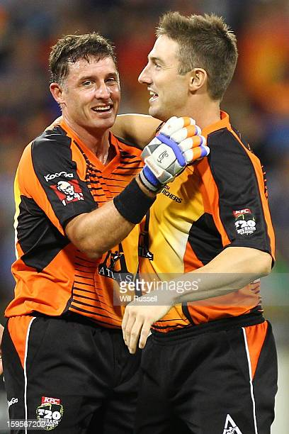 Michael Hussey and Shaun Marsh of Scorchers celebrate after their team's victory during the Big Bash League semifinal match between the Perth...