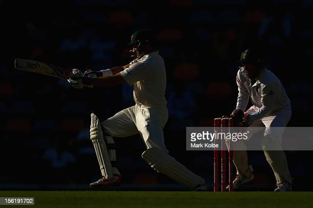 Michael Hussey of Australia bats during day four of the First Test match between Australia and South Africa at The Gabba on November 12 2012 in...