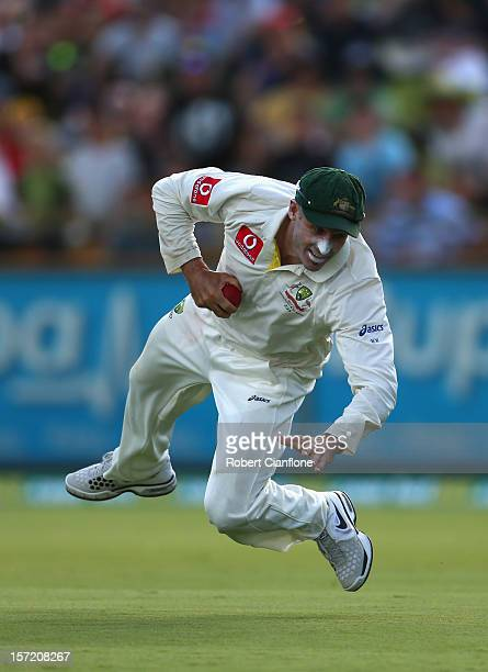 Michael Hussey of Australia catches out Vernon Philander during day one of the Third Test Match between Australia and South Africa at the WACA on...