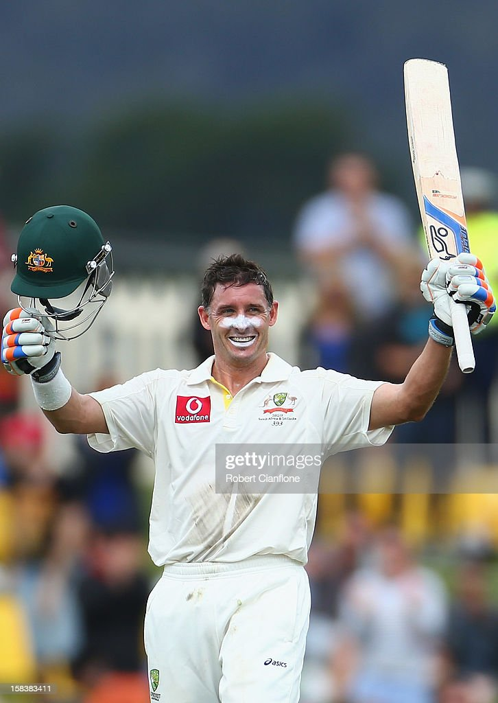 Michael Hussey of Australia celebrates after he scoring his century during day two of the First Test match between Australia and Sri Lanka at Blundstone Arena on December 15, 2012 in Hobart, Australia.