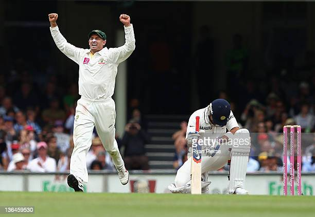 Michael Hussey of Australia celebrates after James Pattinson of Australia dismissed Virat Kohli of India during day four of the Second Test Match...