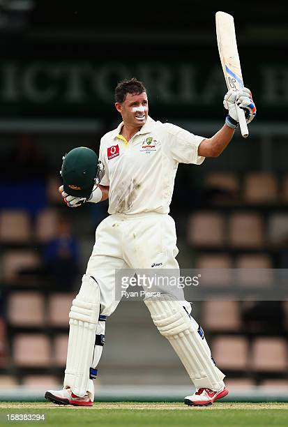 Michael Hussey of Australia celebrates after reaching his century during day two of the First Test match between Australia and Sri Lanka at...