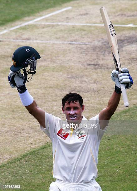 Michael Hussey of Australia celebrates after scoring a century during day three of the First Ashes Test match between Australia and England at The...
