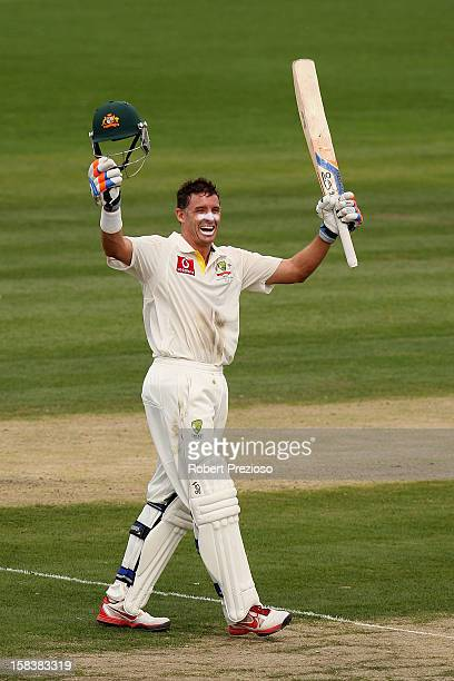 Michael Hussey of Australia celebrates after scoring his century during day two of the First Test match between Australia and Sri Lanka at Blundstone...
