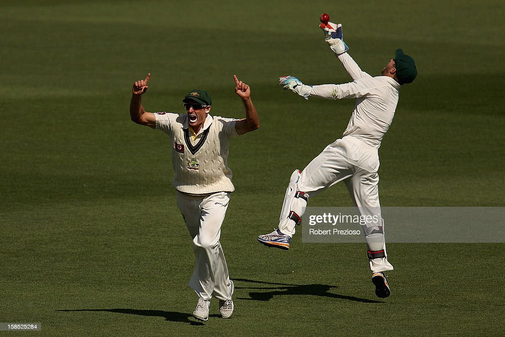 Michael Hussey (L) of Australia celebrates as Matthew Wade (R) of Australia takes a catch to dismiss Angelo Mathews of Sri Lanka off the bowling of Peter Siddle of Australia during day five of the First Test match between Australia and Sri Lanka at Blundstone Arena on December 18, 2012 in Hobart, Australia.