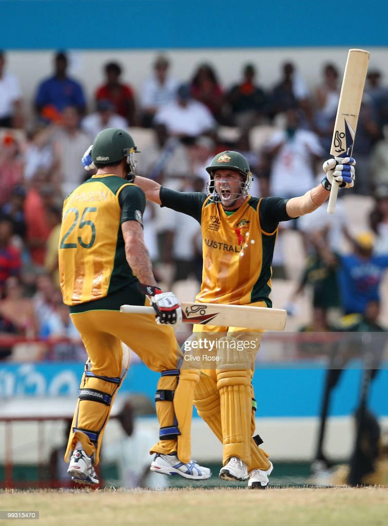 Michael Hussey of Australia celebrates hitting the winning runs with Mitchell Johnson during the ICC World Twenty20 semi final between Australia and Pakistan at the Beausjour Cricket Ground on May 14, 2010 in Gros Islet, Saint Lucia.