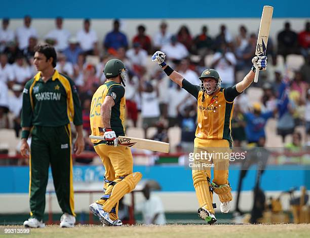 Michael Hussey of Australia celebrates hitting the winning runs with Mitchell Johnson during the ICC World Twenty20 semi final between Australia and...