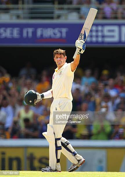 Michael Hussey of Australia celebrates scoring 150 runs during day three of the First Ashes Test match between Australia and England at The Gabba on...