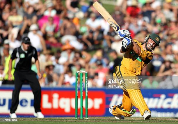 Michael Hussey of Australia is bowled by Shane Bond of New Zealand during the First One Day International match between New Zealand and Australia at...