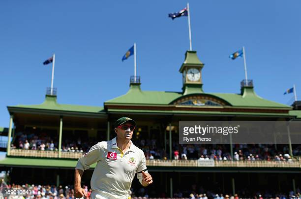 Michael Hussey of Australia leads his team onto the field during his last test during day four of the Third Test match between Australia and Sri...