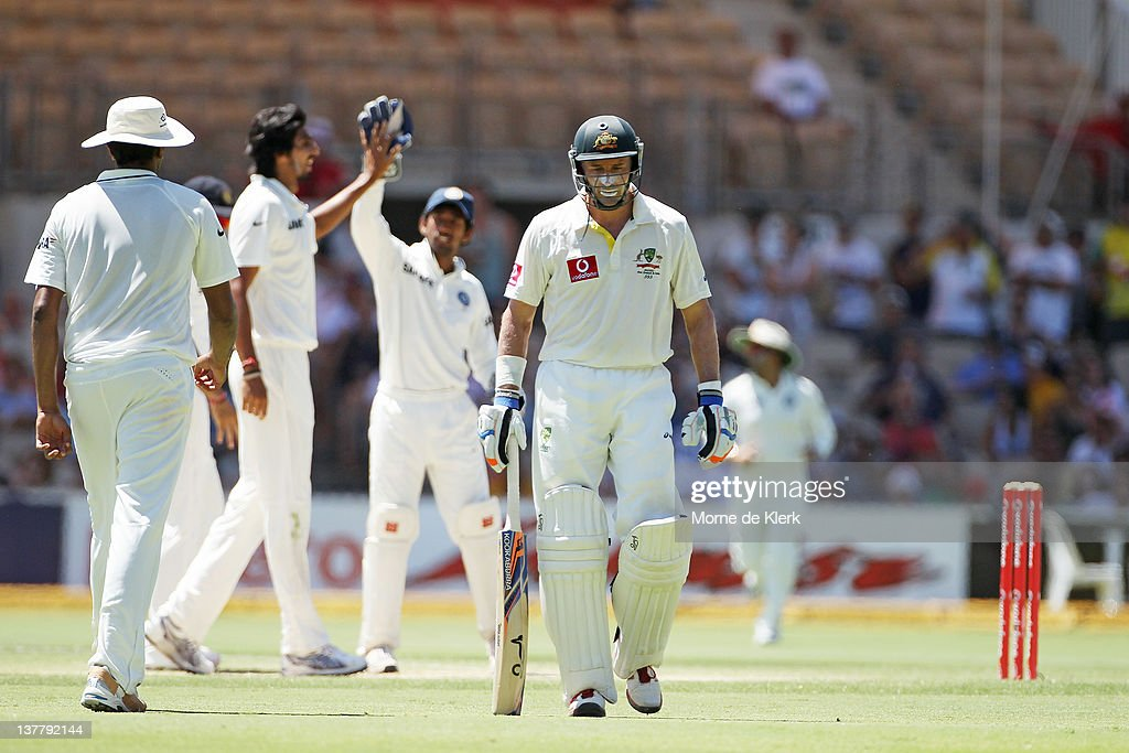 Michael Hussey of Australia leaves the field after getting out as bowler Ishant Sharma of India celebrates with team mates in the background during day four of the Fourth Test Match between Australia and India at Adelaide Oval on January 27, 2012 in Adelaide, Australia.