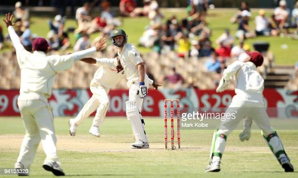 Michael Hussey of Australia looks back as he is caught behind by Denesh Ramdin off the bowling of Dwayne Bravo of the West Indies during day five of...