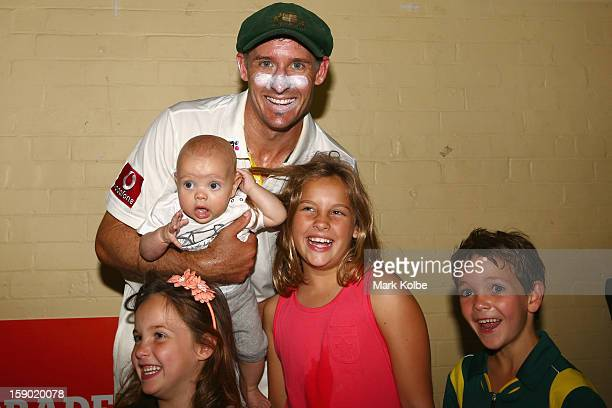 Michael Hussey of Australia poses in the change room with his children Molly Oscar Jasmin and William after his retirement from international cricket...