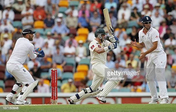 Michael Hussey of Australia pulls for four with Matt Prior and Alastair Cook of England looking on during day two of the First Ashes Test match...