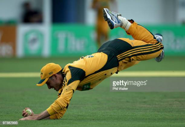 Michael Hussey of Australia takes a catch to dismiss Peter Ingram of New Zealand during the First One Day International match between New Zealand and...