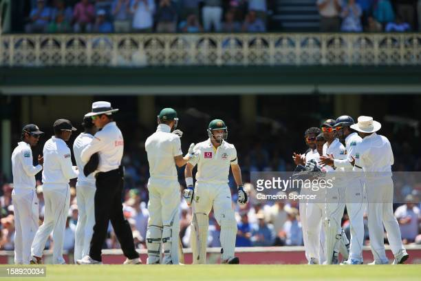 Michael Hussey of Australia walks through a guard of honour onto the pitch in his last test match during day two of the Third Test match between...