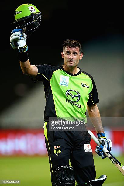 Michael Hussey of the Thunder walks off after being dismissed by Adam Zampa of the Stars during the Big Bash League final match between Melbourne...