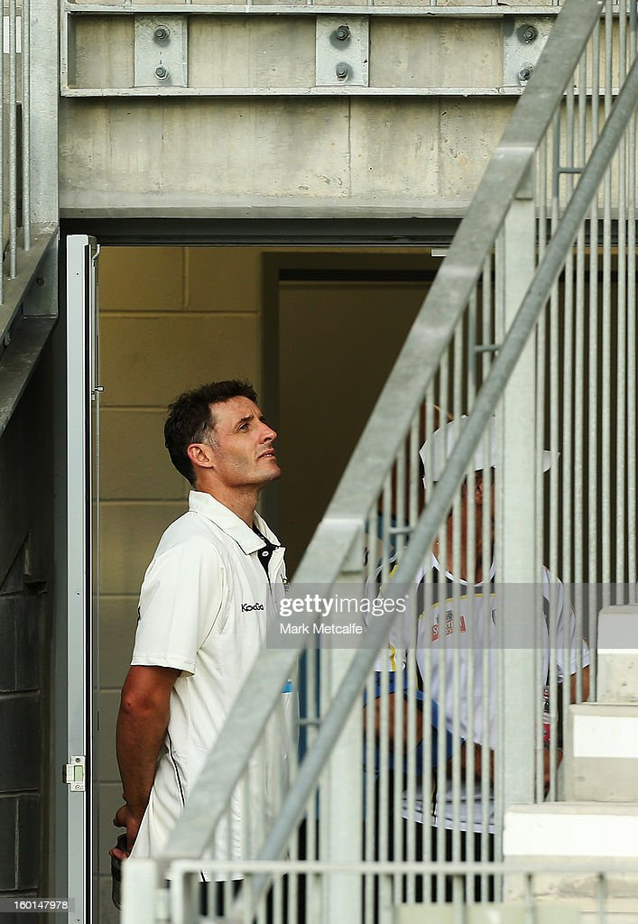 Michael Hussey of the Warriors keeps an eye on the weather during a rain delay on day four of the Sheffield Shield match between the New South Wales Blues and the Western Australia Warriors at Bankstown Oval on January 27, 2013 in Sydney, Australia.
