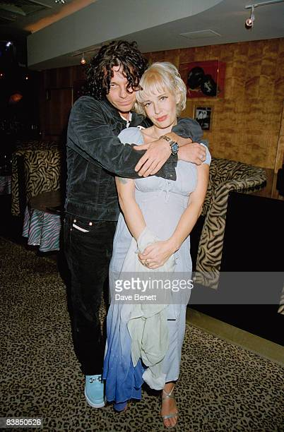Michael Hutchence and Paula Yates attend a screening of 'The Birdcage' at Planet Hollywood in London 15th April 1996