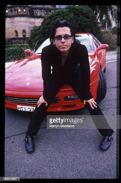 Michael Hutchence driving posing with a Ferrari Sydney Australia 1996
