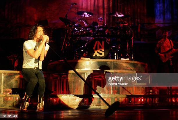 Michael Hutchence lead singer of Australian band INXS performs on stage at the Festhalle in Frankfurt Germany on November 6 1990