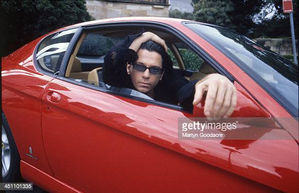 Michael Hutchence singer with INXS poses for portraits with a Ferrari in Sydney Australia 1996