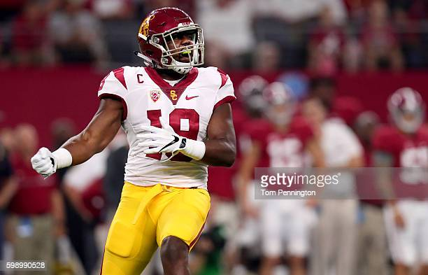 Michael Hutchings of the USC Trojans celebrates against the Alabama Crimson Tide in the first quarter during the AdvoCare Classic at ATT Stadium on...