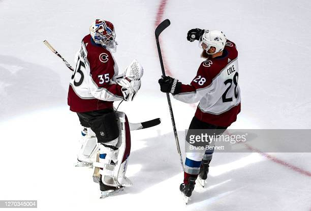Michael Hutchinson and Ian Cole of the Colorado Avalanche celebrate their teams 4-1 victory against the Dallas Stars in Game Six of the Western...