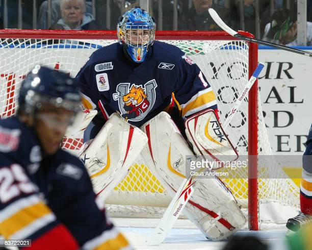 Michael Hutchinson of the Barrie Colts waits to make a save in a game against the London Knights on November 14, 2008 at the John Labatt Centre in...