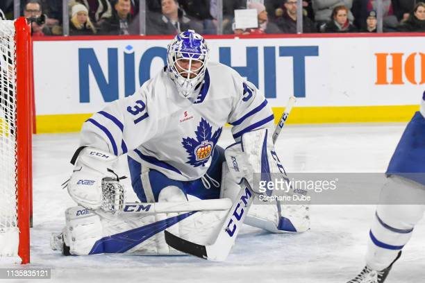 Michael Hutchinson of the Toronto Marlies shifting direction to follow the play against the Laval Rocket at Place Bell on March 6 2019 in Laval Quebec