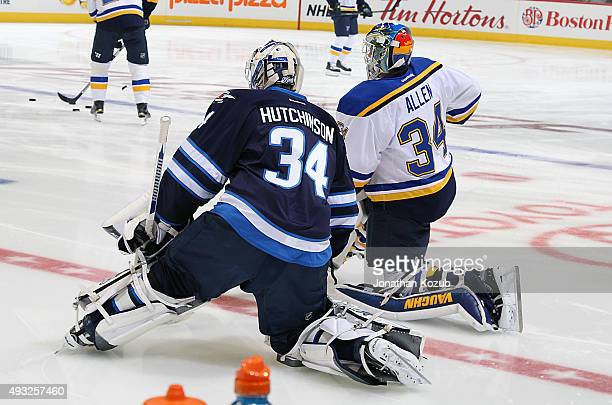 Michael Hutchinson of the Winnipeg Jets and Jake Allen of the St Louis Blues take part in the pregame warm up prior to NHL action at the MTS Centre...