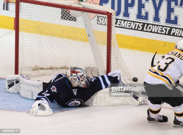Michael Hutchinson of the Winnipeg Jets blocks a shot from Brad Marchand of the Boston Bruins in shootout action in an NHL game at the MTS Centre on...